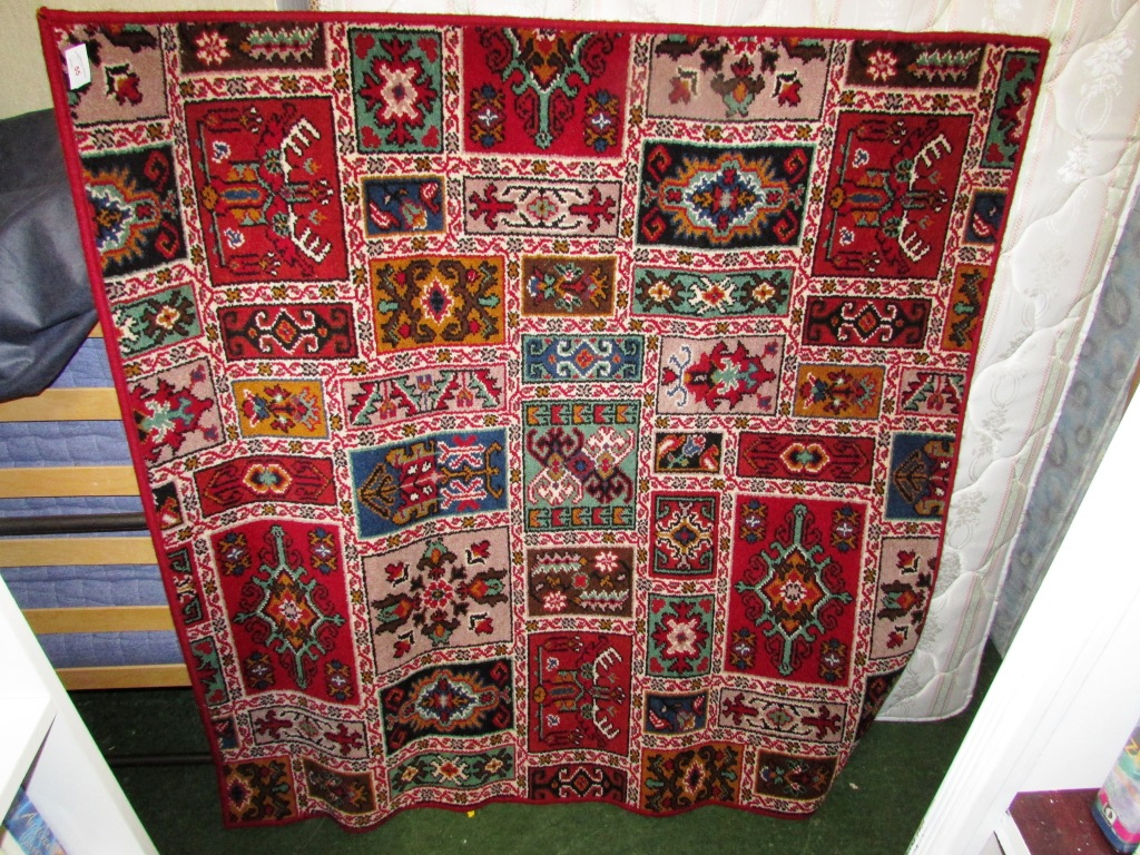 Lot 55 - RED GROUND AXMINSTER 100 WOOLLEN CARPET