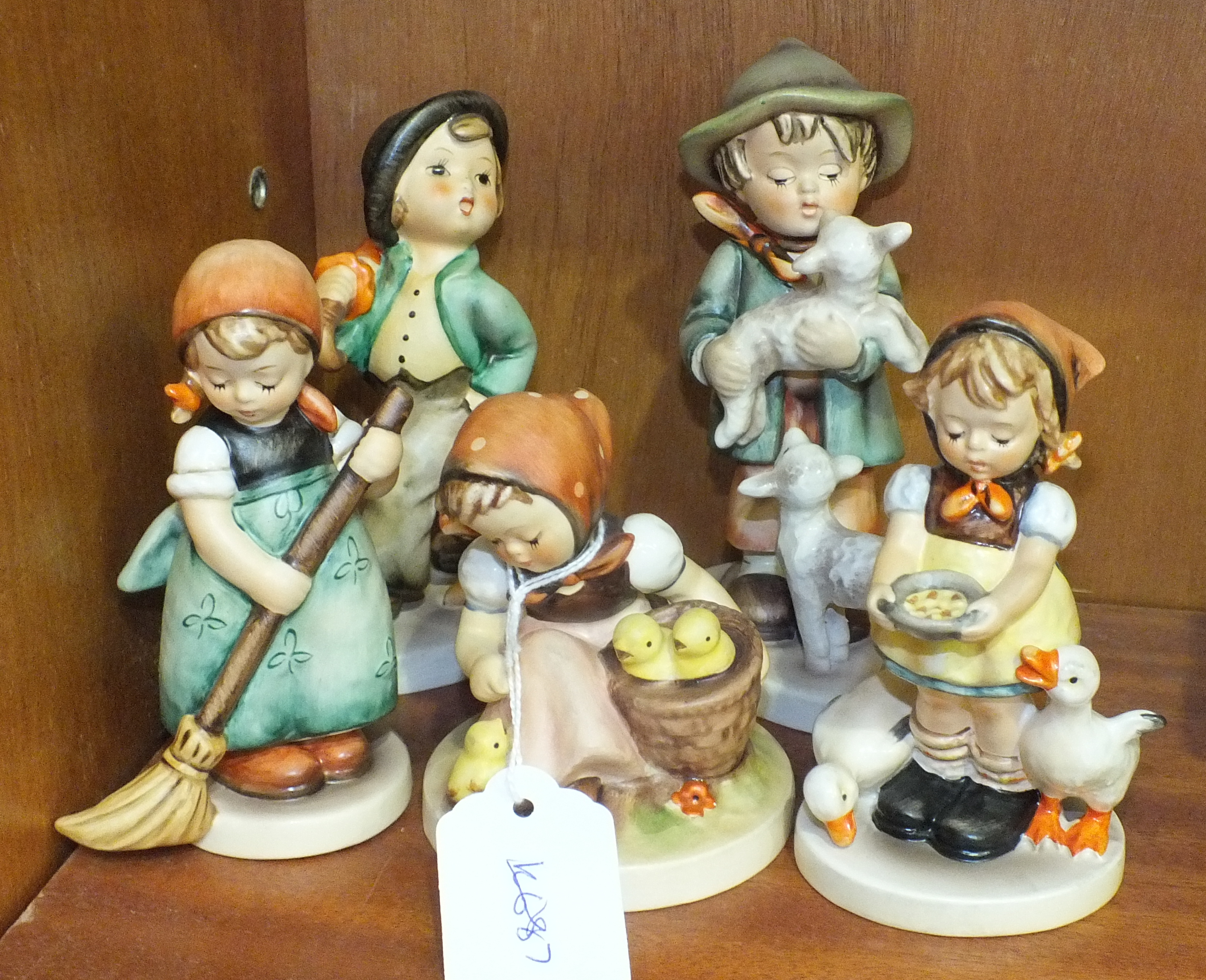 Lot 110 - A collection of five Goebel figures, 'Shepherd's Boy', 13.5cm, 'Chick Girl', 9cm, 'Little