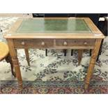 A stained pine two-drawer writing table, the rectangular top with inset writing surface, on turned