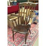 An elm and beech lathe-back farmhouse-style armchair, (needs strengthening).
