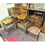 Two wood frame armchairs, a corner chair, a trunk stand and other items.