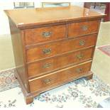 A reproduction burr walnut straight-front chest of two short and three long drawers, 98cm wide.