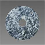 A RICHLY TEXTURED NEOLITHIC BI DISC IN GREEN JADE WITH A STRIKING MARBLE-LIKE PATTERN Jade. China,