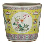 A Chinese lemon green ground famille rose jardiniere, decorated with flowers, fruits and bats, 19thC