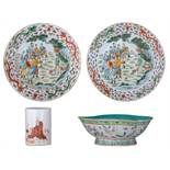 Two Chinese polychrome dishes, the centre decorated with figures, the rim with dragons; added a ditt