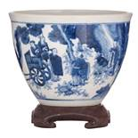 A Chinese transitional type blue and white jardiniere, decorated with figures, on a matching hardwoo