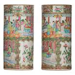 Two Chinese Canton cylindrical vases, decorated with birds and animated scenes, H 31 cm