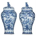 A pair of Chinese blue and white vases and covers, decorated with birds and flowers, 19thC, H 43 cm