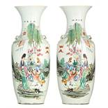A pair of Chinese famille rose vases, decorated with an animated scene, 19thC, H 57,5 cm