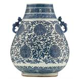 A Chinese blue and white archaistic hu-vase, the pear-shaped body densely decorated with lotus scrol