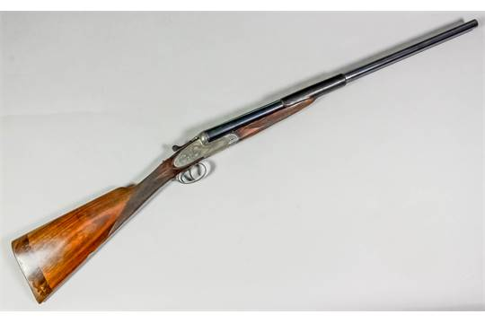 A 12 bore Black Sable Delux model side by side shotgun by