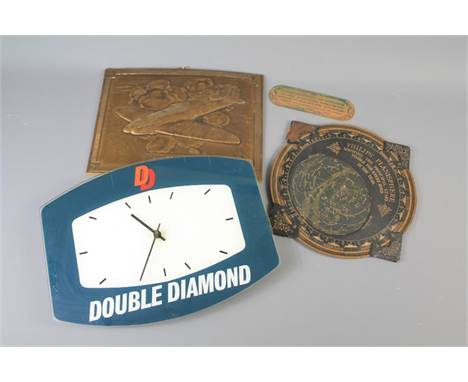 A Perspex Double Diamond Advertising Clock. The battery operated clock approx 35 x 27 cms together with Phillip's Planisphere