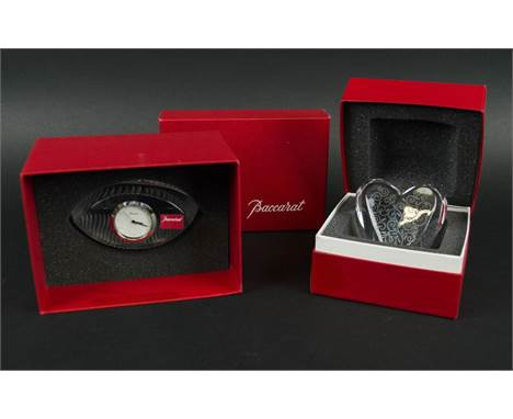 BACCARAT CRYSTAL EMPREINTE PAPERWEIGHT CLOCK, along with a heart shaped paper weight with  scrolling etched foliate decoratio