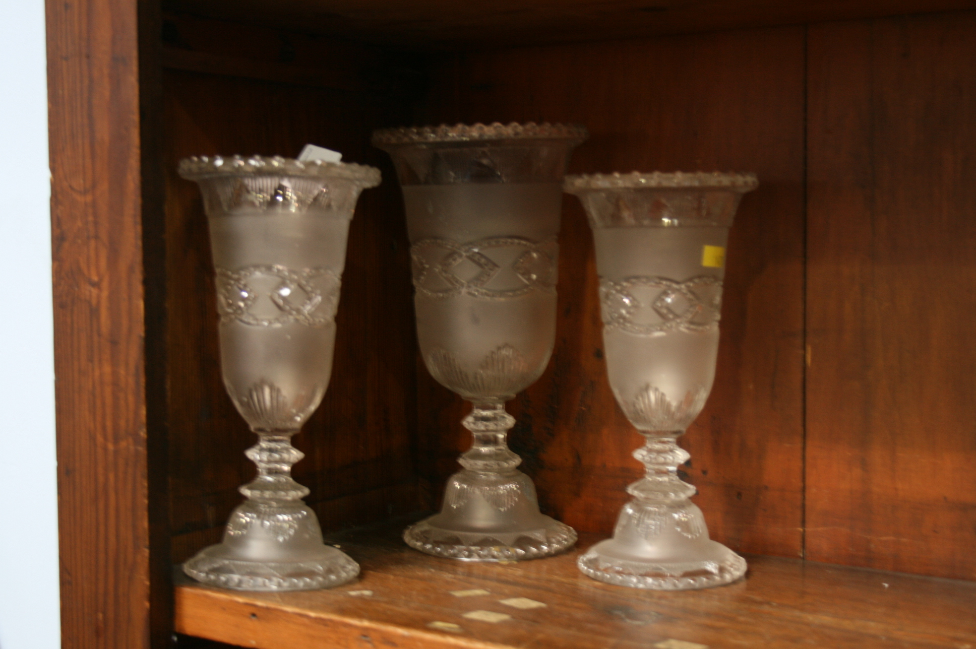 Lot 31 - A garniture of three glass vases