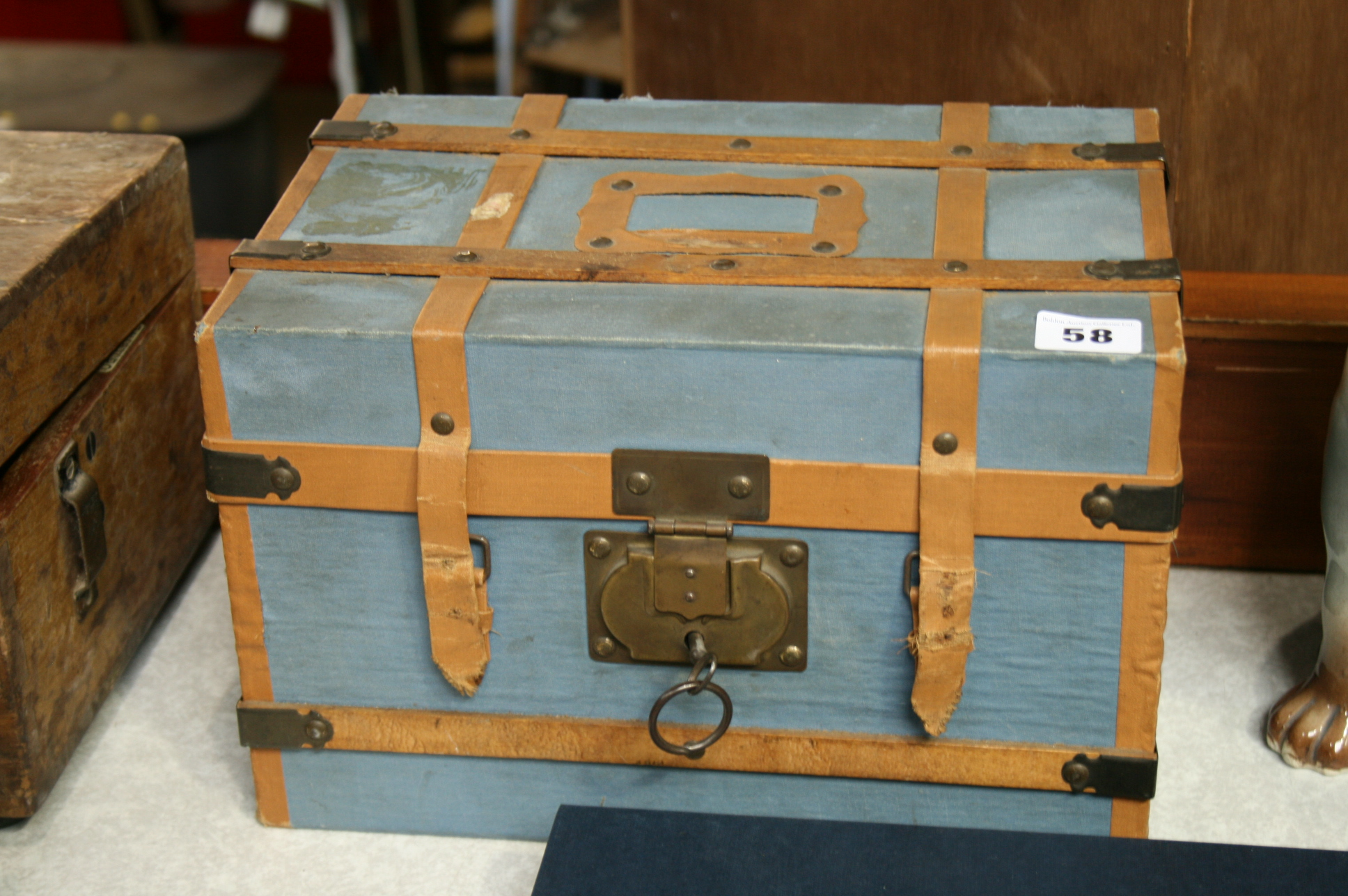 Lot 58 - A small travelling cabin trunk