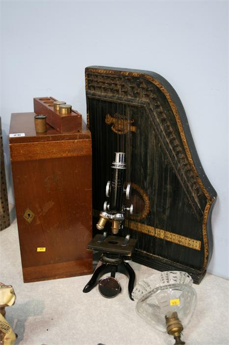 Lot 26 - Zither and a microscope