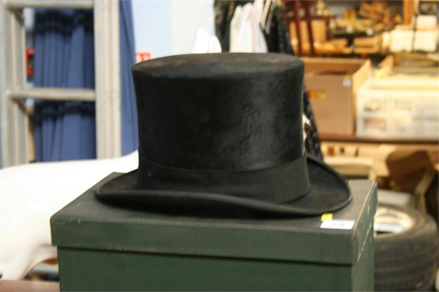 Lot 49 - Dunn & Co. of London top hat and box