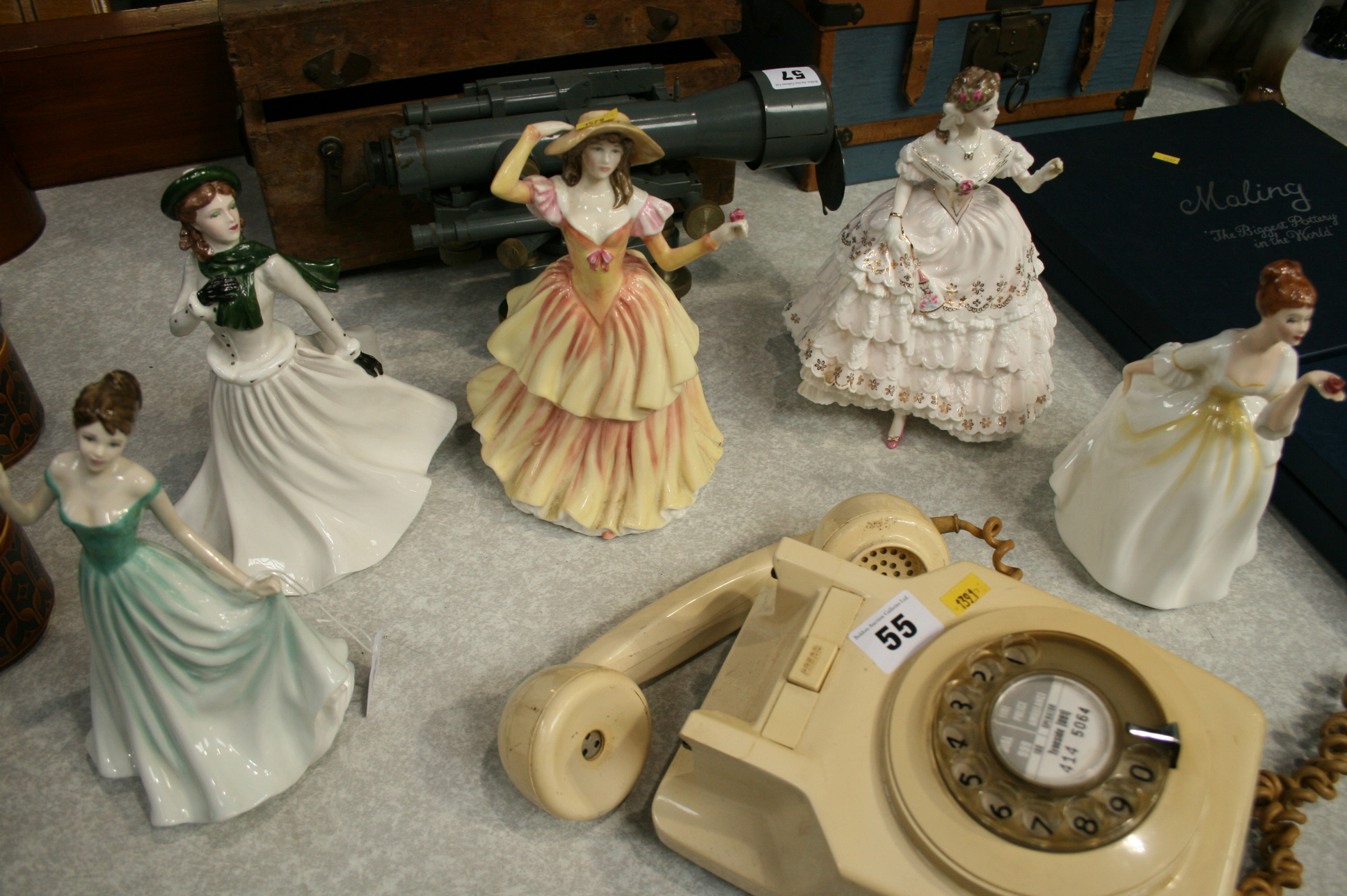 Lot 56 - Four Royal Doulton and one Coalport figures
