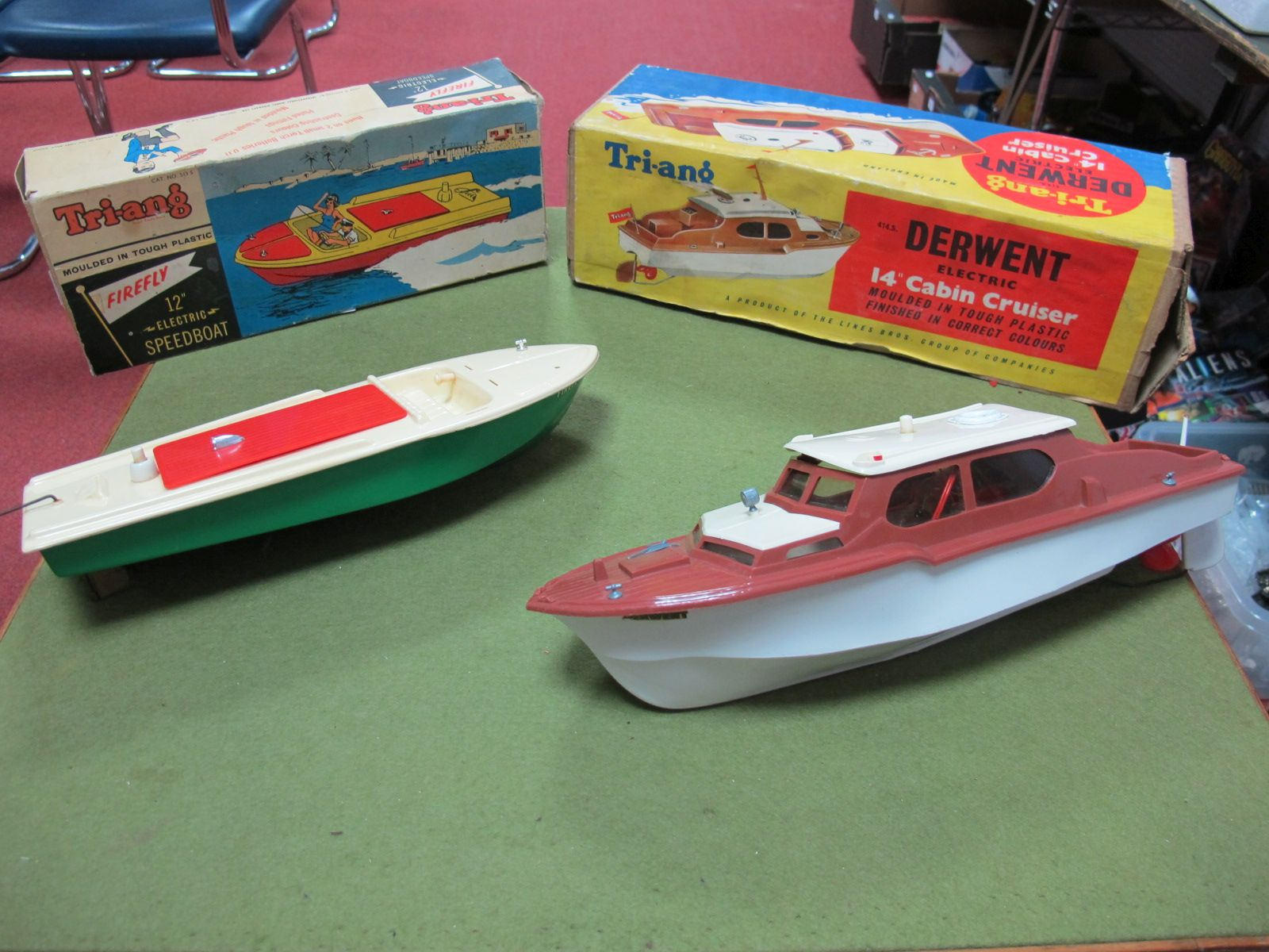 """Lot 28 - A Boxed Triang #414.S Derwent 14"""" Cabin Cruiser, with electric motor - some 'bananaring' to roof,"""