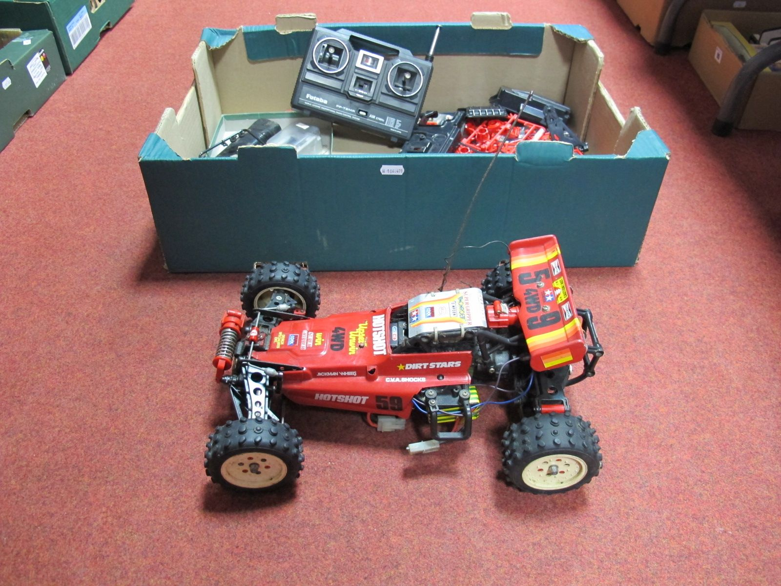 Lot 46 - A Tamiya Hotshot Radio Control Buggy, radio gear fitted, with Futaba transmitter, Acoms fast charger