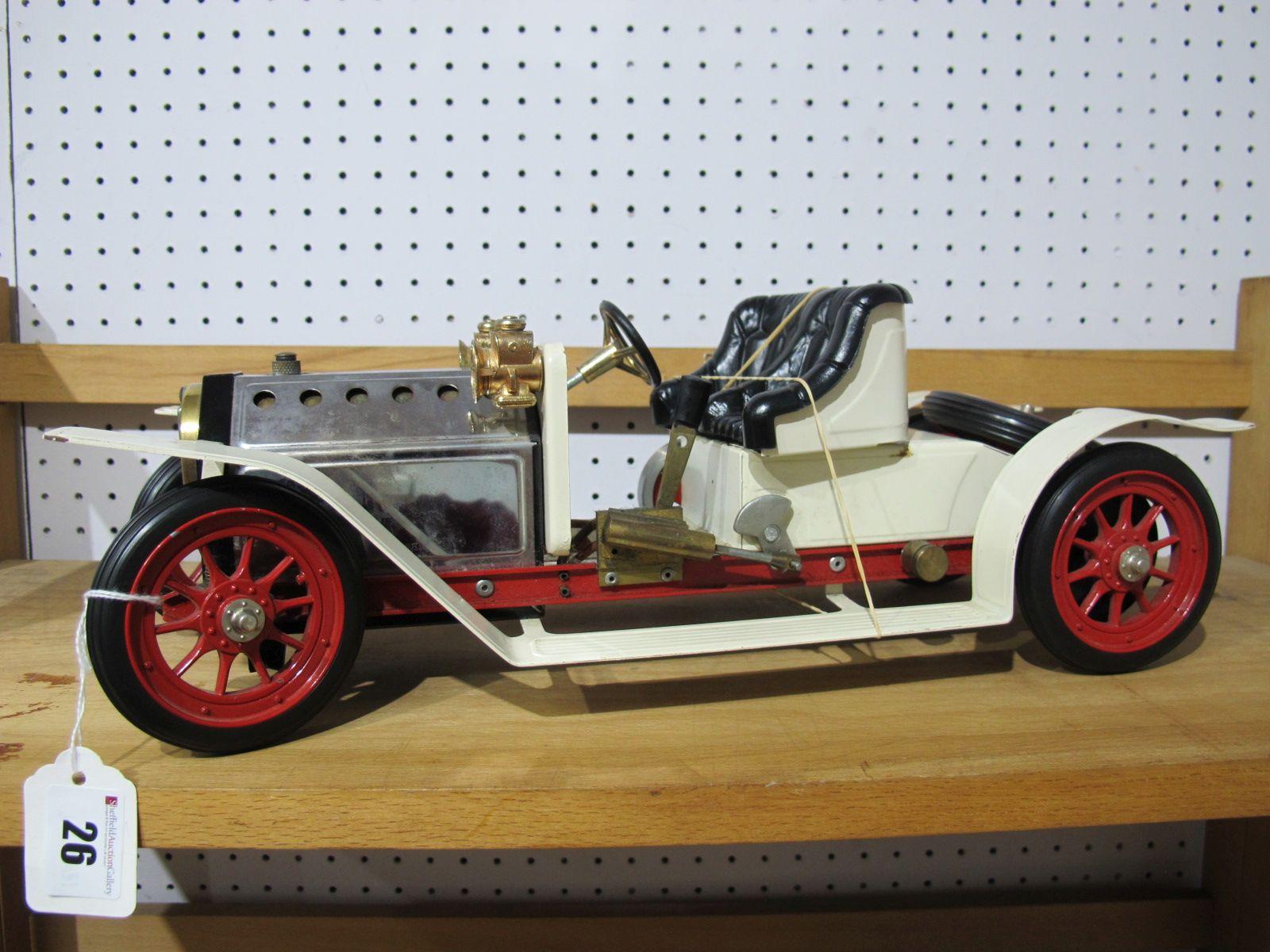 Lot 26 - A Mamod Live Steam SA1 Roadster, ten spoke wheel model with boiler sight glass. Model has been