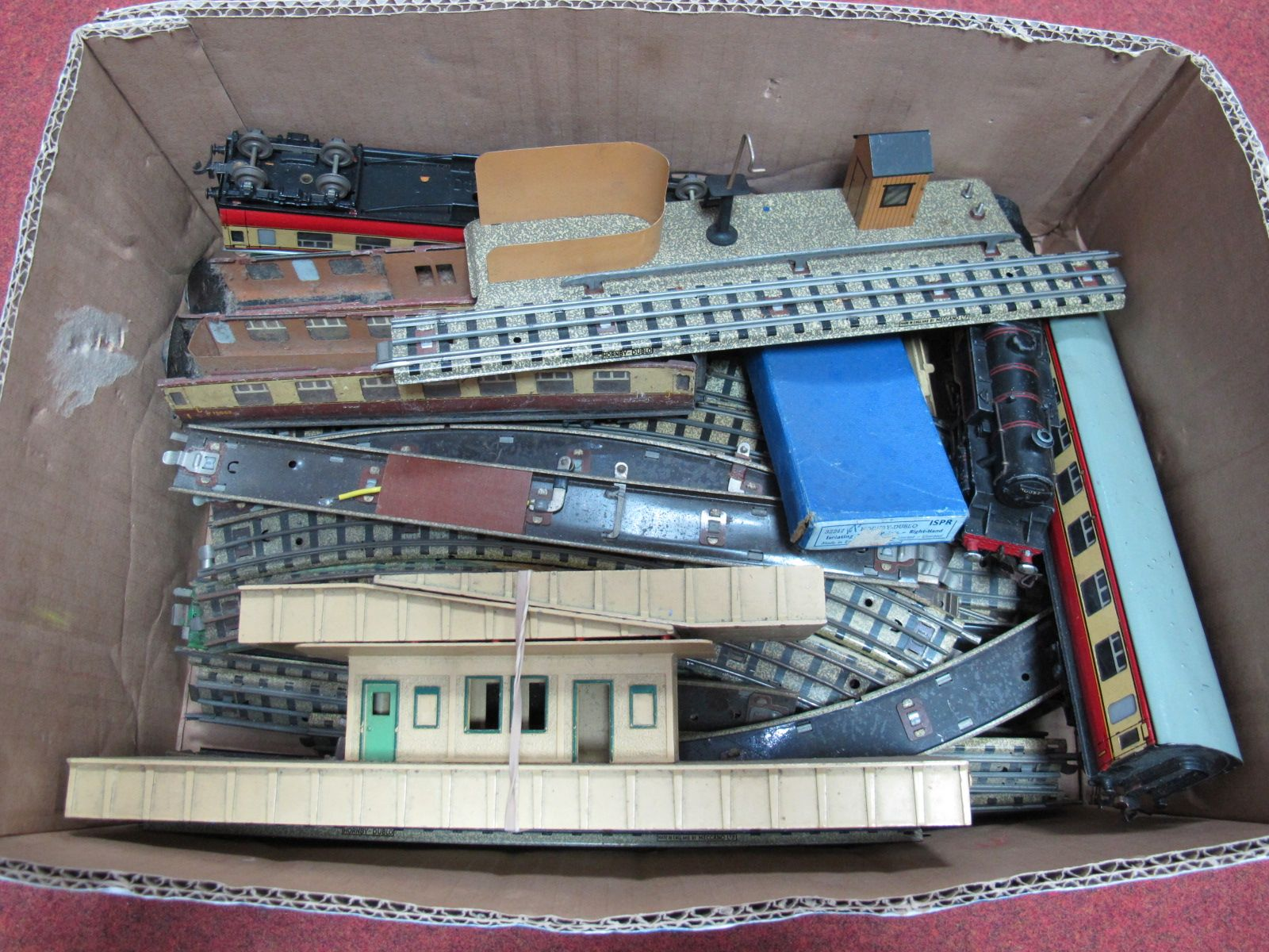 Lot 36 - A Hornby Dublo Three Rail 2-6-4 Steam Locomotive, with platforms, carriages, three rail track and