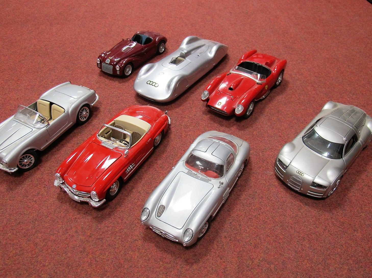 Lot 40 - Seven 1:18th Scale Highly Detailed Diecast Model Cars, by Revell, Hot Wheels, Maisto and Burago.