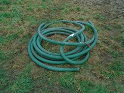 Lot 1 - Roll of green plastic pipe