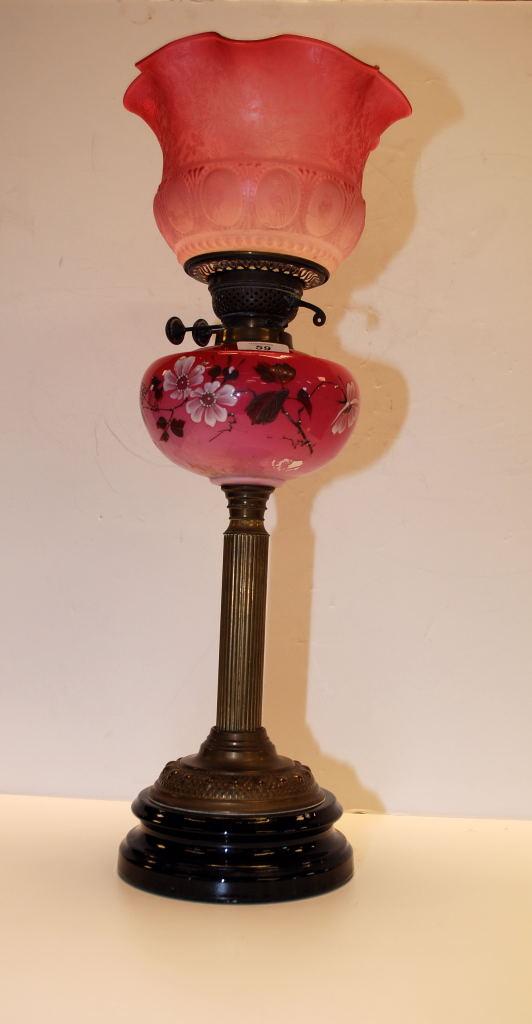 Lot 59 - A CRANBERRY OIL LAMP WITH BRASS CORINTHIAN COLUMN,