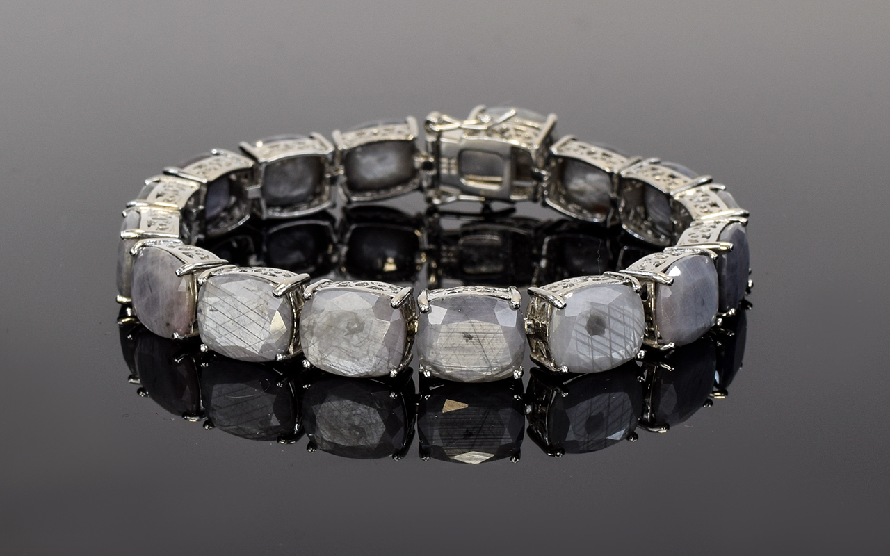 Lot 103 - Natural Silver Sapphire Tennis Bracelet,