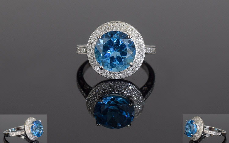 Lot 151 - 14ct White Gold Blue Topaz & Diamond Rin