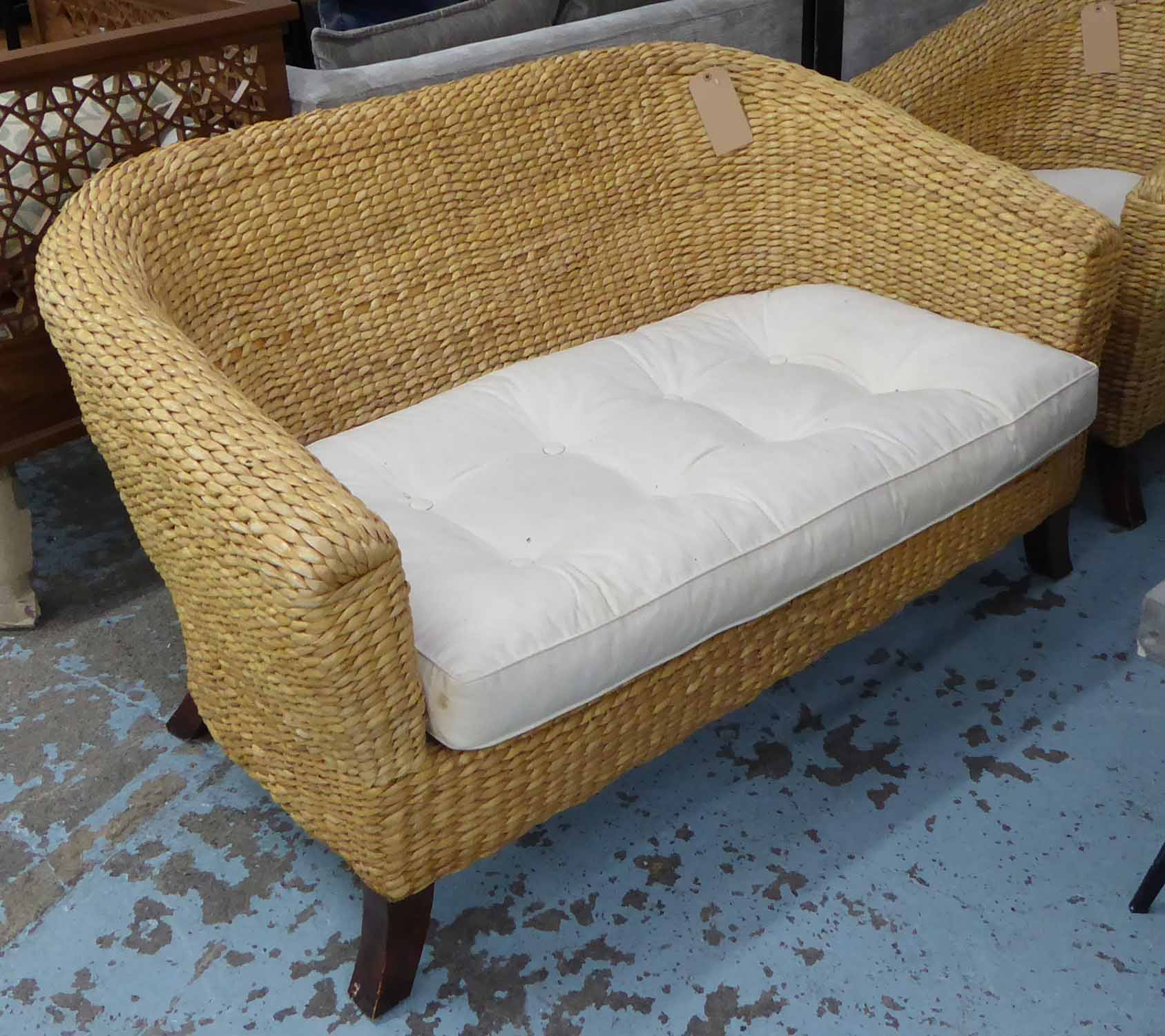 CONSERVATORY WICKER SOFA, rounded back on splayed legs, with cushion and chair to match.