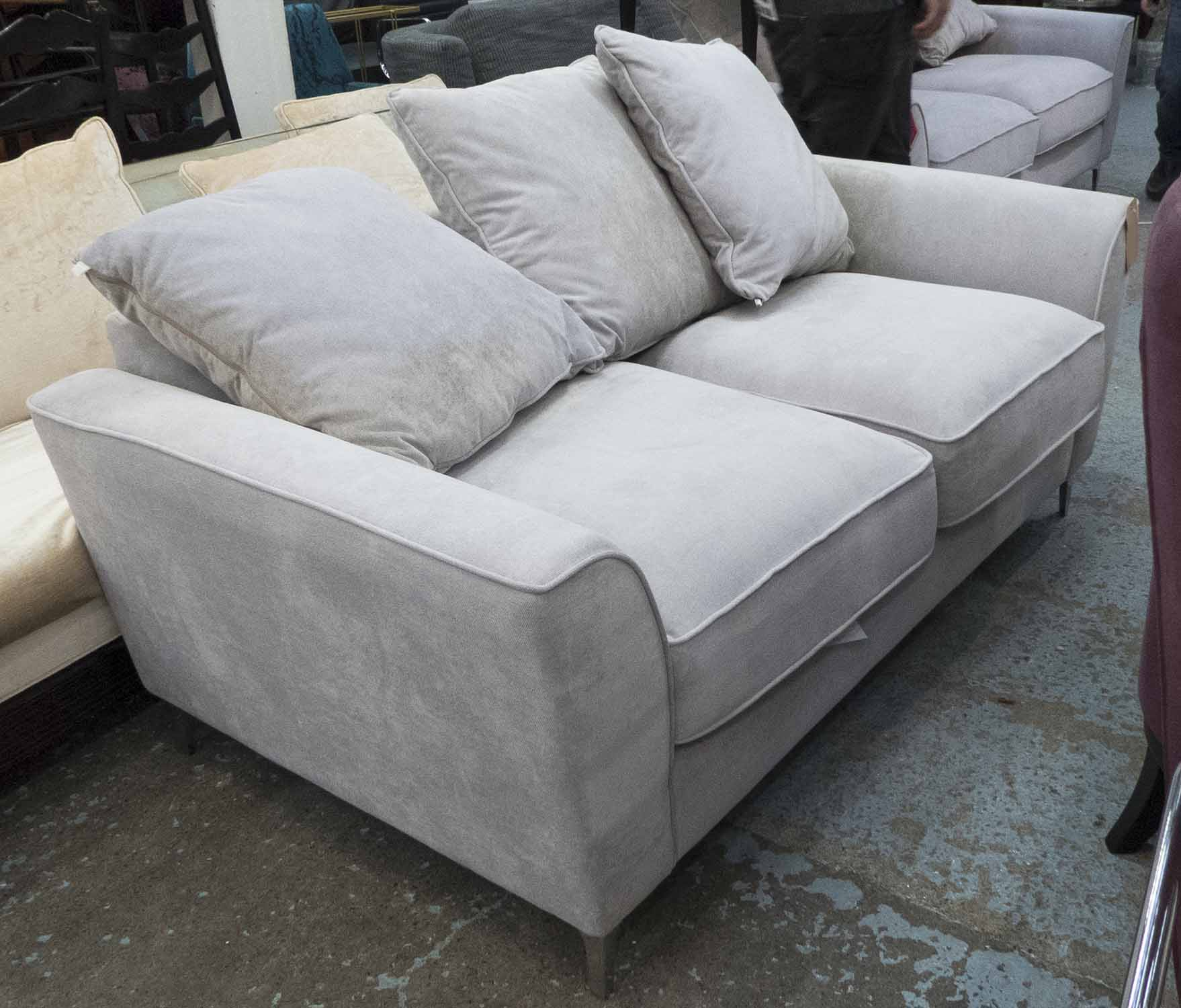 Lot 36 - SOFA, two seater, in grey fabric on chromed metal supports plus three cushions, 176cm L.