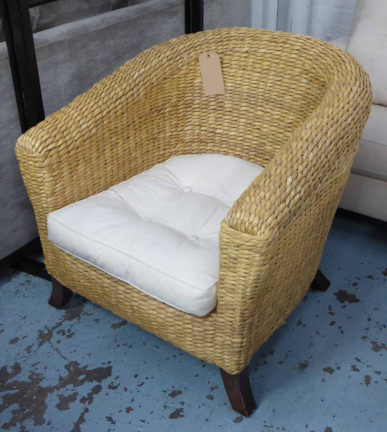 CONSERVATORY WICKER SOFA, rounded back on splayed legs, with cushion and chair to match. - Image 2 of 2