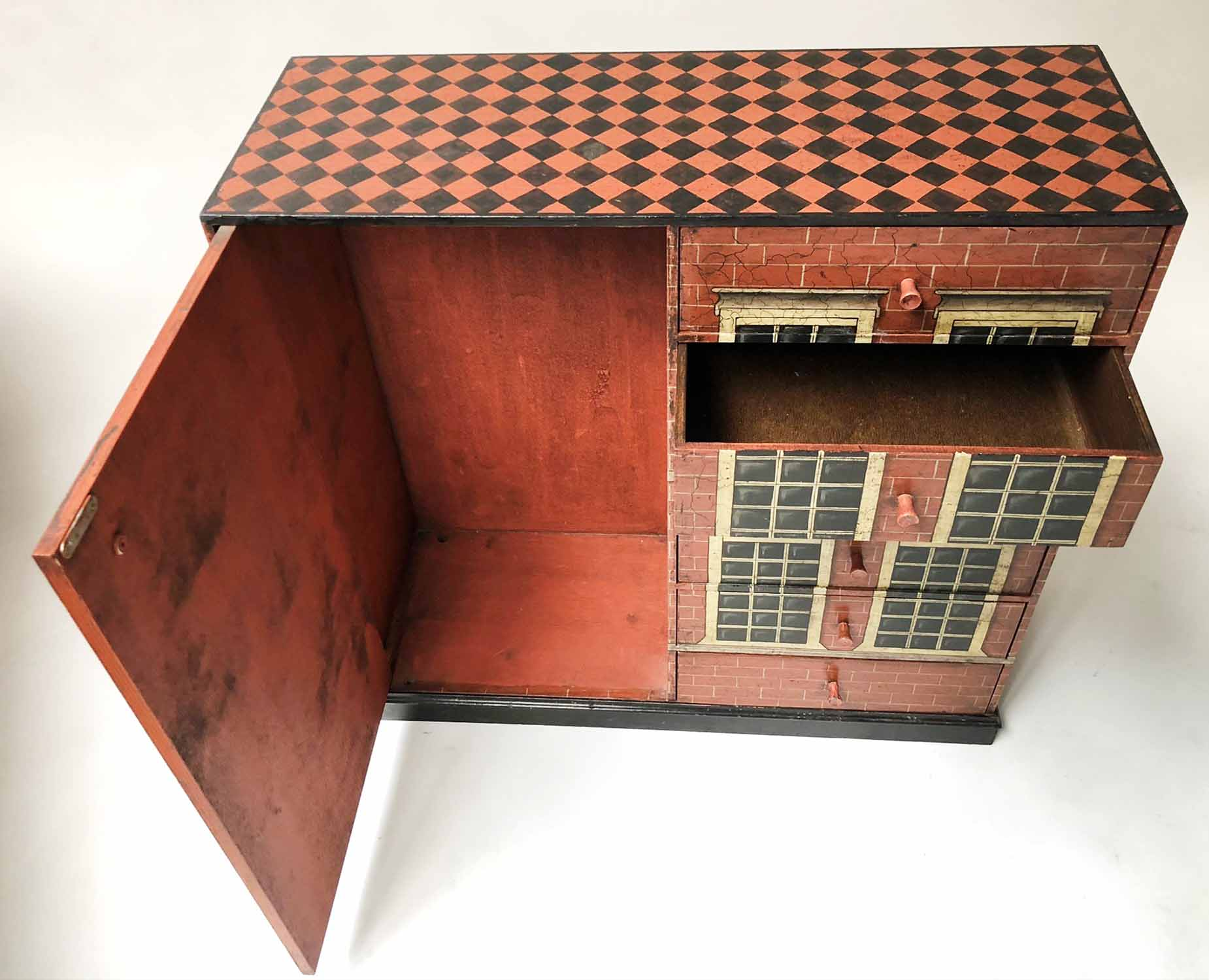 Lot 45 - DOLLS HOUSE CHEST, with six short drawers flanked by cupboard painted as a Georgian townhouse,