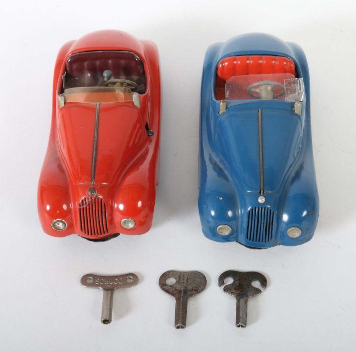 2 Rennwagen Schuco, 1 x Examico 4001, rot, Uhrwerkantrieb, Stopphebel, Gangschaltung, orange - Bild 3 aus 4