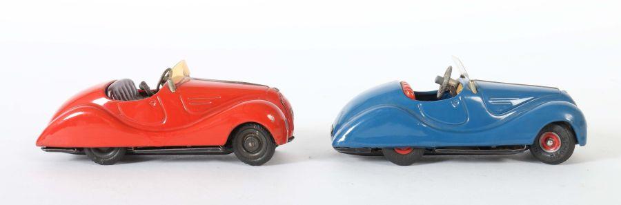 2 Rennwagen Schuco, 1 x Examico 4001, rot, Uhrwerkantrieb, Stopphebel, Gangschaltung, orange - Bild 2 aus 4