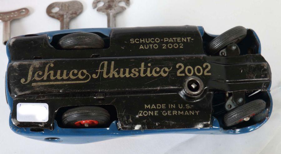 2 Rennwagen Schuco, 1 x Examico 4001, rot, Uhrwerkantrieb, Stopphebel, Gangschaltung, orange - Bild 4 aus 4