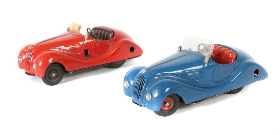 2 Rennwagen Schuco, 1 x Examico 4001, rot, Uhrwerkantrieb, Stopphebel, Gangschaltung, orange