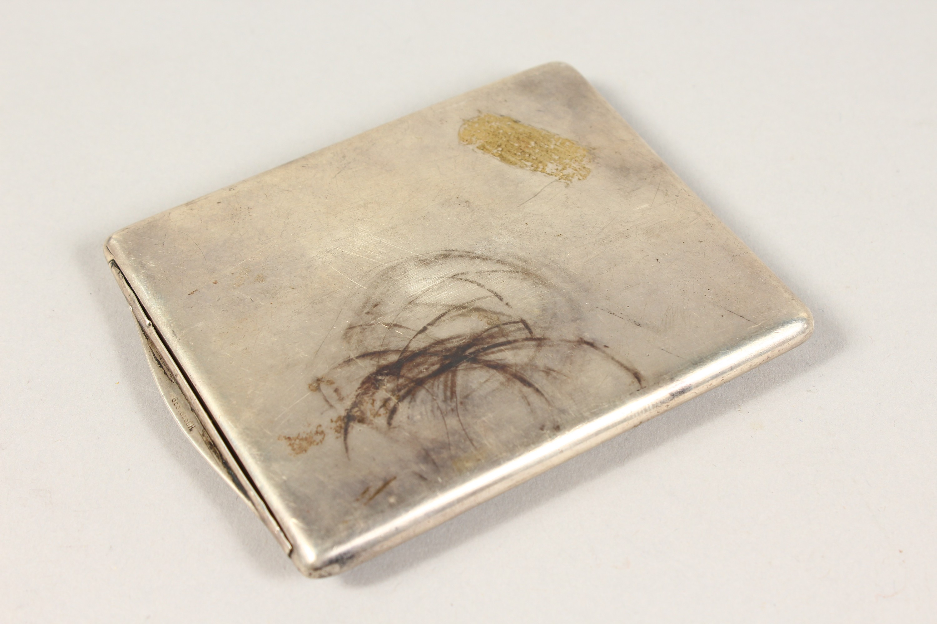 Lot 1714 - A GOOD CONTINENTAL SILVER CIGARETTE CASE, stamped GES GESCH, the lid with a horse and jockey.