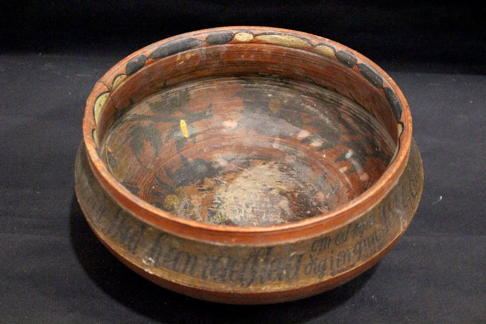 Lot 25 - A MID 19TH CENTURY NORWEGIAN 'ROSEMALING' ALE BOWL, decorated with biblical script and dated 1840,