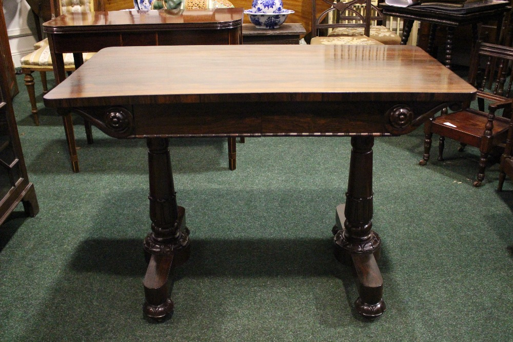 A GOOD QUALITY ROSEWOOD WILLIAM IV LIBRARY TABLE, neat size, with 2 frieze drawers, having carved