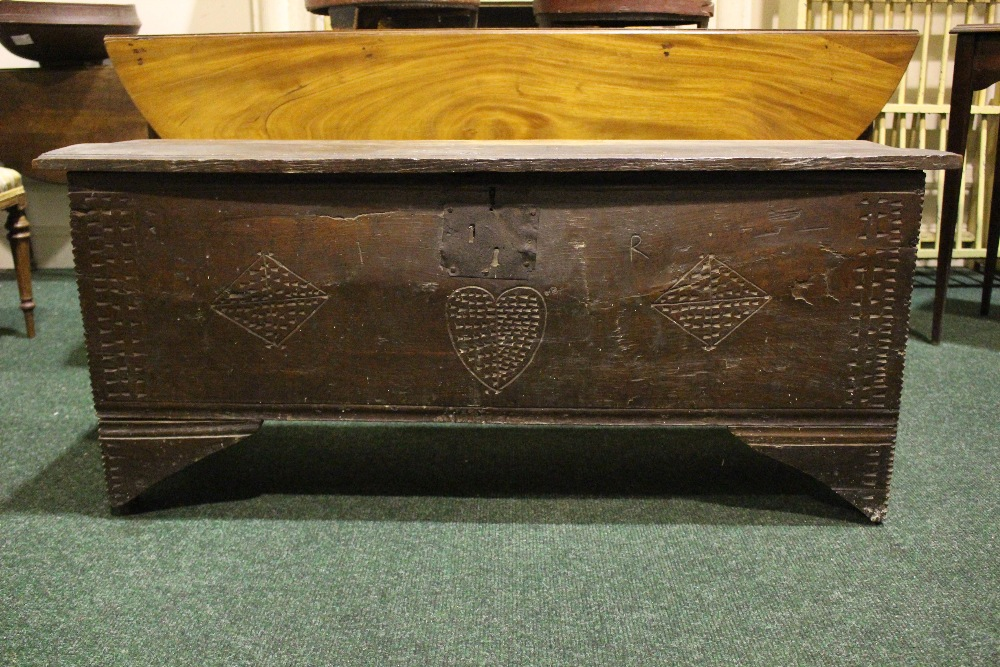 AN OAK COFFER CHEST / MARRIAGE CHEST, with carved initials to the front and a love heart motif to
