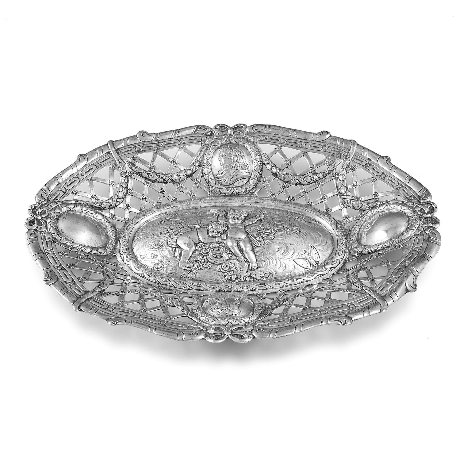 ANTIQUE GERMAN SILVER DISH of oval form with pierced and chased decoration, a scene of cherubs to