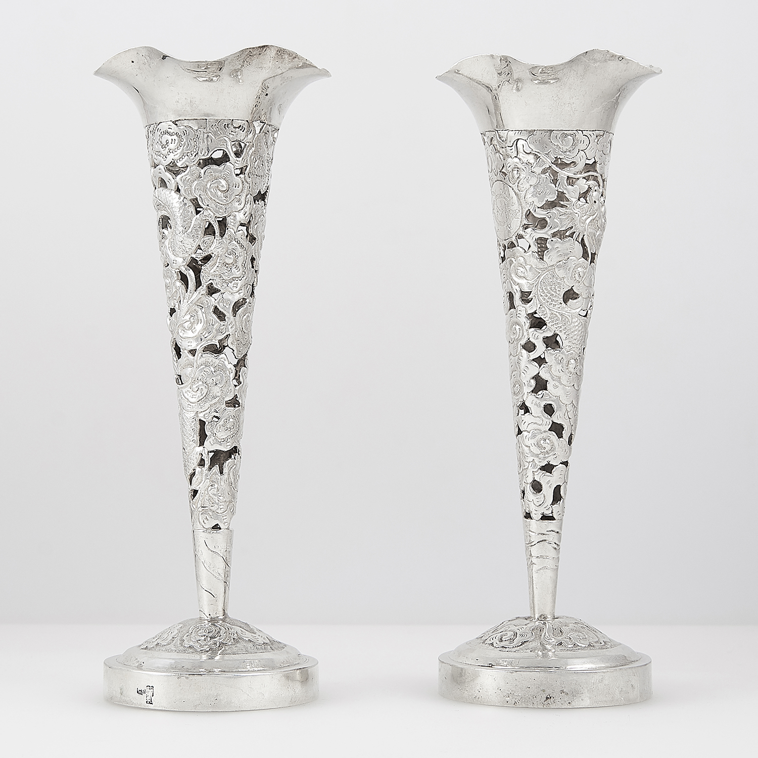 PAIR OF ANTIQUE CHINESE SILVER VASES CIRCA 1900 the fluted bodies with pierced and chased