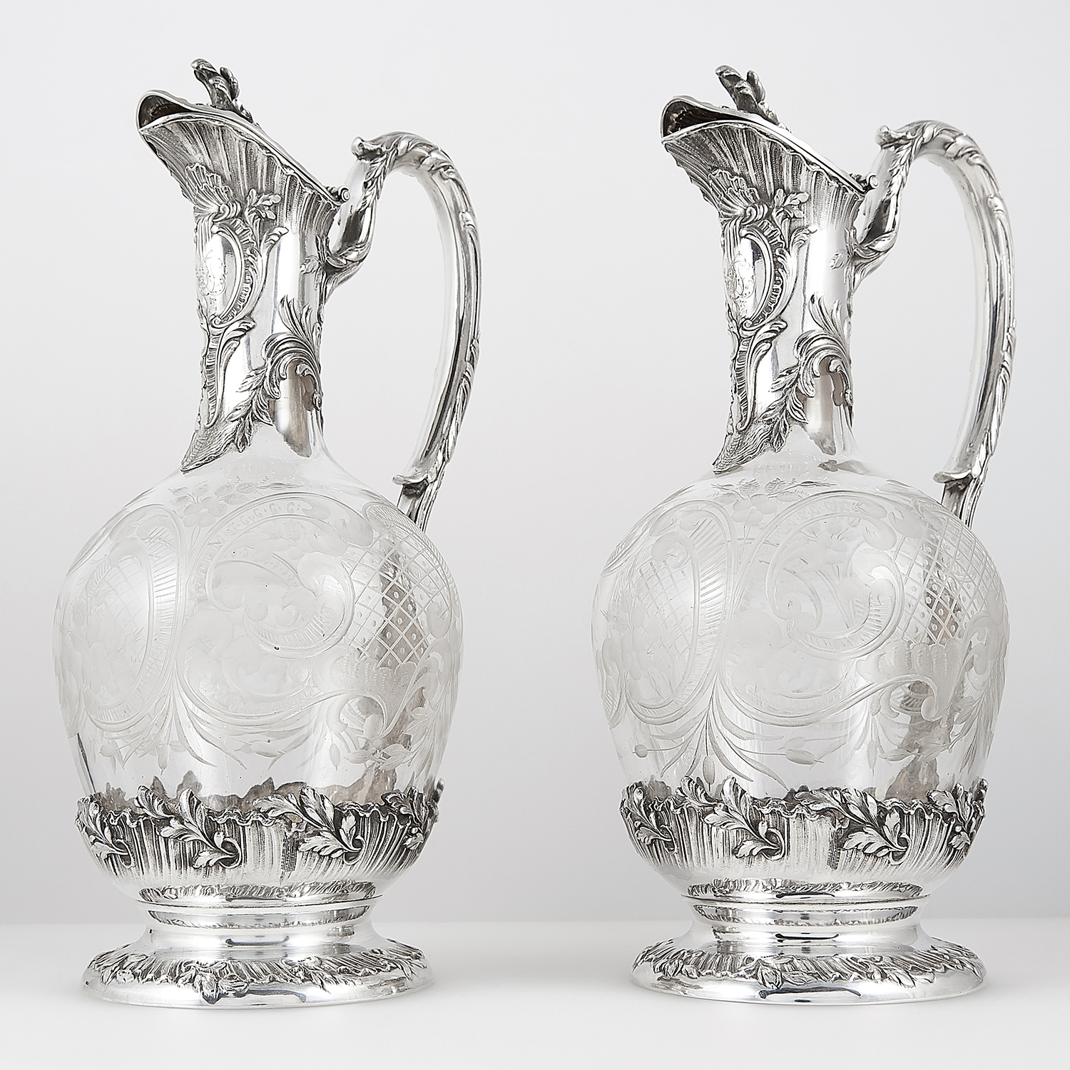 PAIR OF ANTIQUE FRENCH SILVER MOUNTED CUT GLASS CLARET JUGS, TETARD FRERES CIRCA 1890 the bulbous