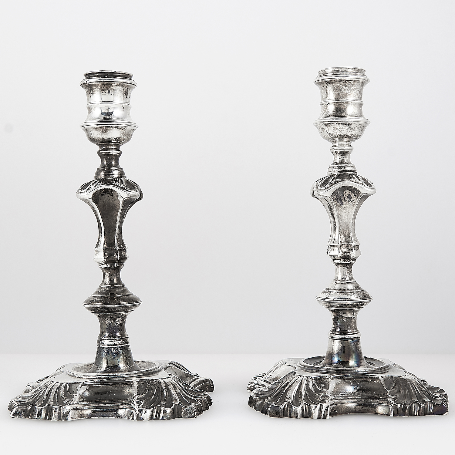 PAIR OF ANTIQUE GEORGE III STERLING SILVER CANDLESTICKS, JAMES GOULD, LONDON 1767 the stylised stems