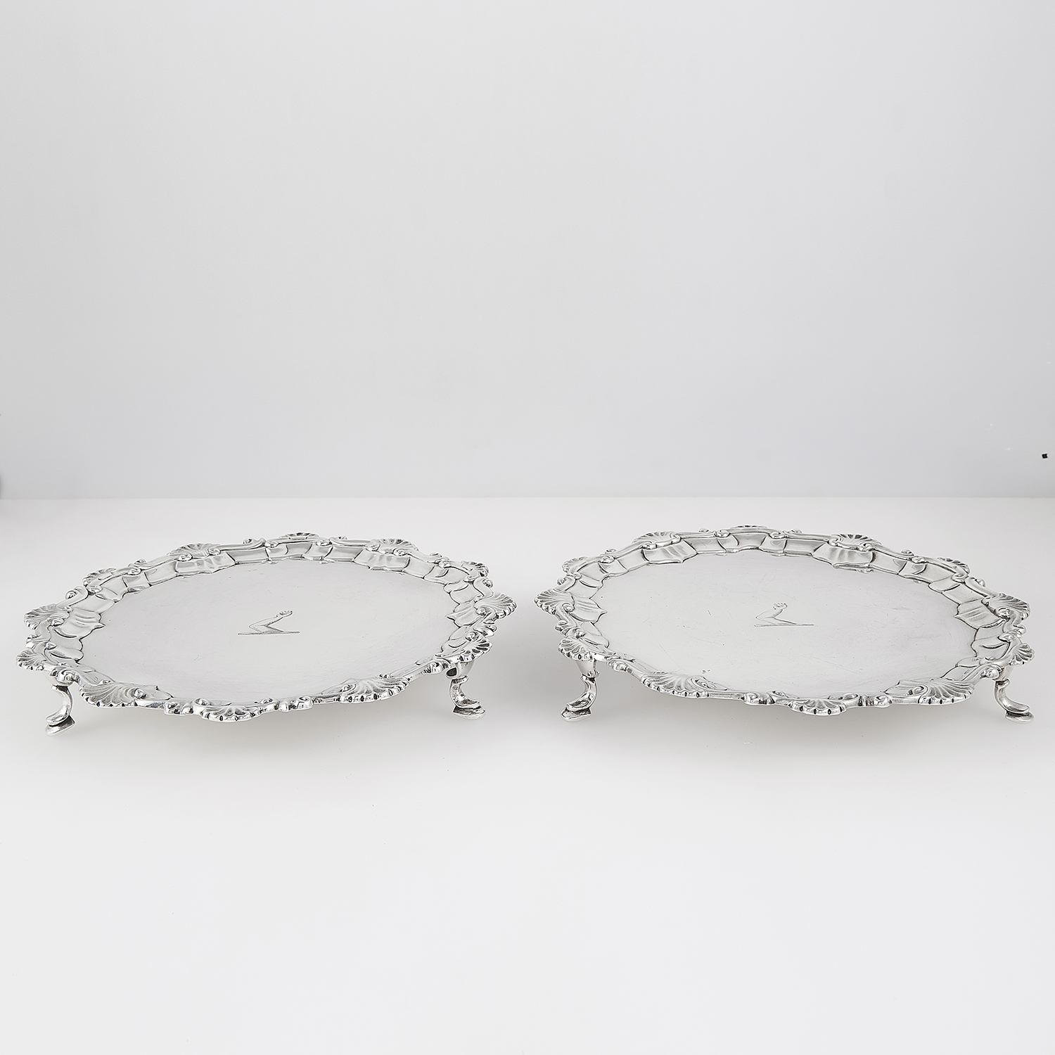 Los 18 - TWO MATCHED GEORGE II / III STERLING SILVER SALVERS, DOROTHY MILLS 1752 AND JOHN CROUCH 1770 of