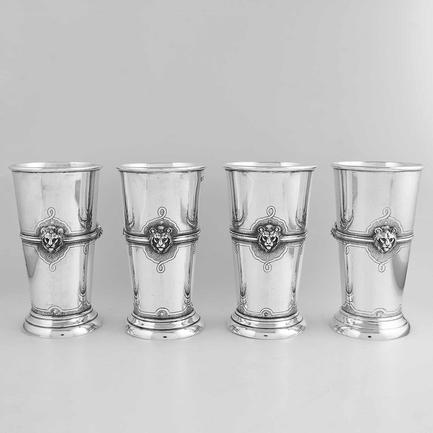 FOUR ANTIQUE STERLING SILVER BEAKERS / CUPS, D & J WELLBY, LONDON 1910 the tapering bodies with
