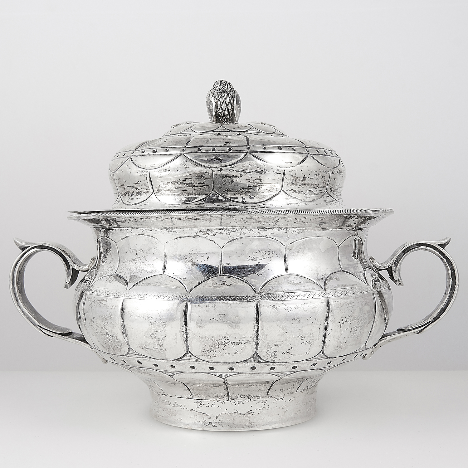 ANTIQUE MEXICAN SILVER POT AND COVER, 19TH CENTURY circular baluster form with chased decoration,